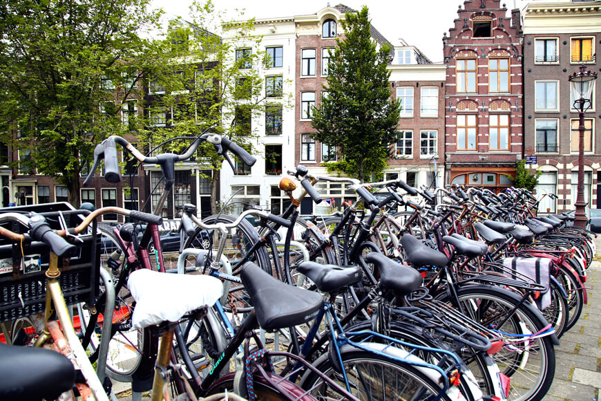 Rows of crowded bike parking lots signal large bike culture